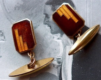 Cuff links, Art Deco, vintage.  Oblong with cut corners, Basse-taille enamel in shades of rust and orange. c 1930's to early 40's..