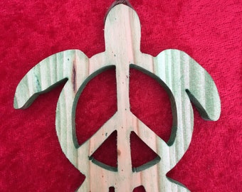 Handmade wooden ornament made from a recycled Christmas tree Peace sign Sea Turtle