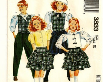 "A Buttoned Blouse, Buttoned Vest, Tiered Skirt, and Pull-On Pants Fashion Sewing Pattern: Girls Size 10, Breast 28-1/2"" • McCall's 3833"