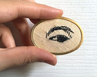"Hand Embroidered Lover's Eye, Gold Oval Pin, Japanese Female Warrior Eye, 40mm x 55mm (1.6""x 2.2"")"