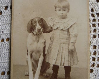 Baby girl and her dog photography 1900 child girl portrait and her pet genuine vintage sepia photography baby girl pic in dress with ruffles