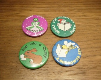 Vintage 1980s library badges, a little worn but still fun