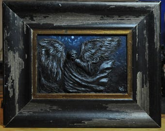 Low relief with wooden frame