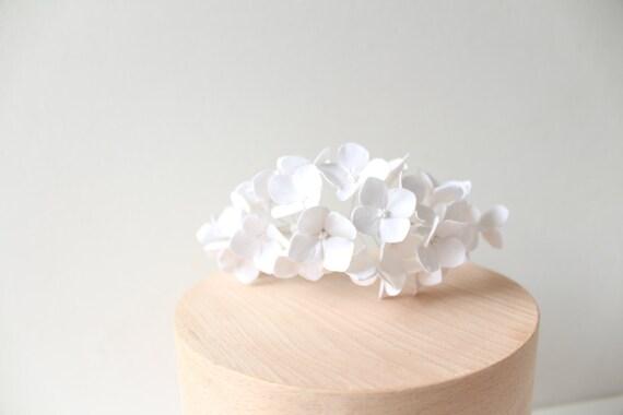 White wedding tiara headband, white hydrangea with white center on white stems on a white Alice headband. wedding hair flower