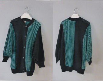80s oversized cardigan. XXL size. Black with turquoise motifs sweater.Wool/synthetic pullover with bat sleeves. Ιn a good vintage condition.