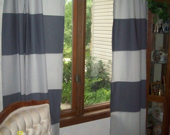 The blending of two shades of Gray makes a pretty set of curtains. This standard length of 44 x 84  compliments a bedding set  on way fair.