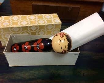 Vintage wooden geisha doll. In original box.