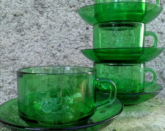 Four French 'La bonne arquebuse'  'vereco' green glass cups and saucers