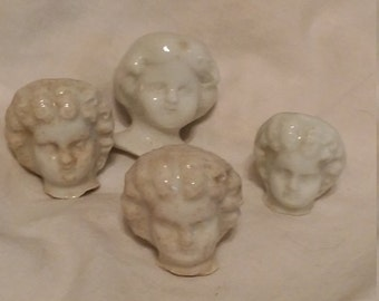 Porcelain doll heads. Doll head. Ceramic doll head. Old doll head. Vintage doll head. Vintage porcelain. Doll parts. Porcilain dolls