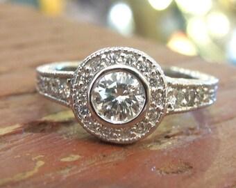 Half Carat Diamond Halo Engagement Ring in 18K White Gold