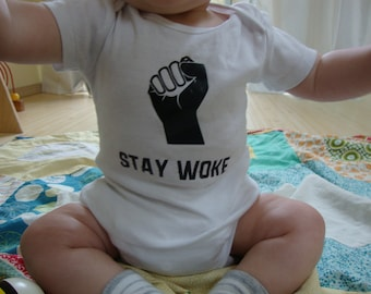Stay Woke baby protest bodysuit
