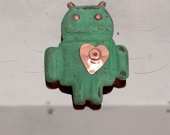 Android in copper  with a heart - a riveted one
