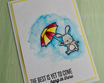 Rabbit and Umbrella Hang in There greeting card