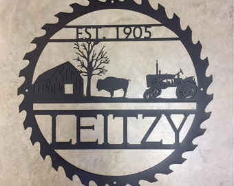 Metal Sawblade sign with BISON and Barn scene