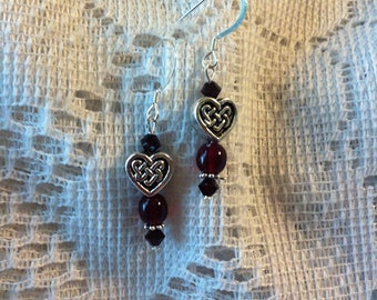Dark red garnet and silver pierced earrings with Celtic knot heart shape beads