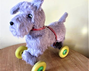 Large Vintage Pull Along Plush Grey Dog On Wheels In Very Good Condition.