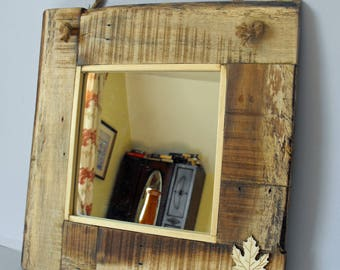 Handmade rustic mirror with rope or wood trim made from re-claimed wood
