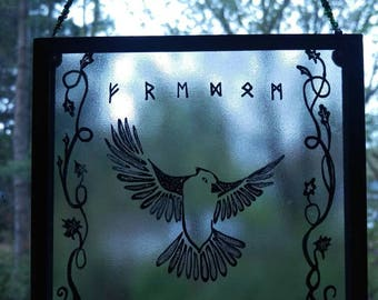 Freedom to Fly. Stained glass painted bird with futhark