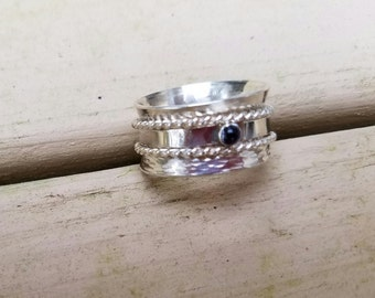 Sterling silver and amethyst triple spinner ring