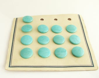 13 Mint green buttons on a card, vintage sewing buttons with shaks,  18mm, unused!