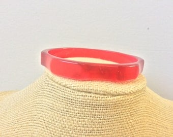 Red pearlized lucite bangle bracelet