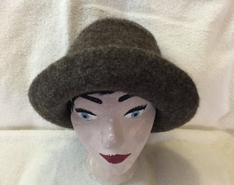 fuzzy medium brown wool felted hat with cord.