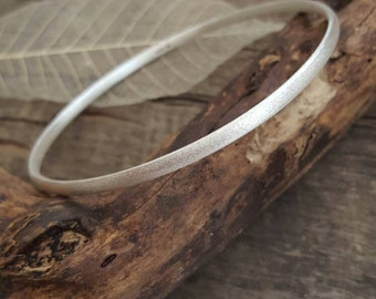 Sterling silver bangle with a frosted finish