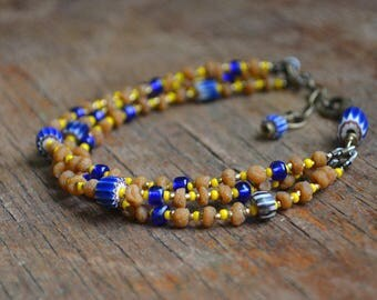 Trade bead bracelet with antique chevron beads and sweet detar seeds, multi strand