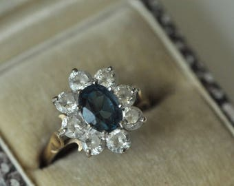 A Topaz and CZ 9k Gold Ring
