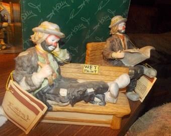 Two Emmett Kelly Jr figurines