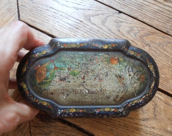 A French vintage decorative tin candy box