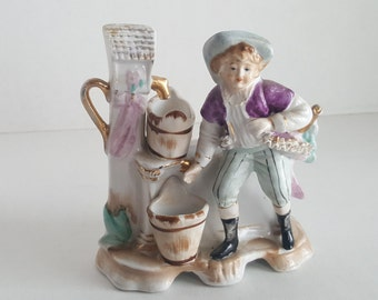 Porcelain figural planter boy at water well