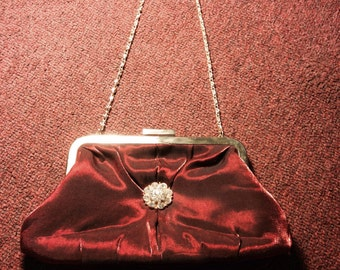 80's does 50's red satin evening bag with gold brooch and gold accents