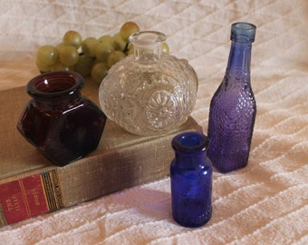 Collection of 4 Small Bottles - Blue Emerson Drug Company, 2 Purple, and 1 Clear