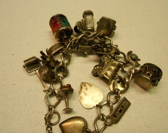 Vintage Sterling Charm Bracelet with 21 Sterling Charms from the 1920's/1930