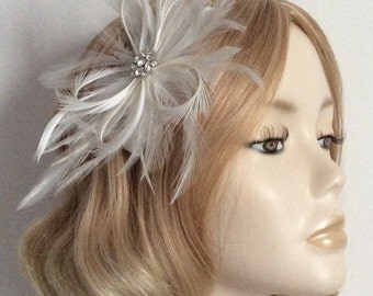 WHITE FEATHER FASCINATOR,With hackle and biot Feathers, crystal detail, on a comb.