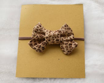 cheetah hair bow on nylon elastic or hair clip, baby nylon elastic headband, newborn headband, child cheetah headband, cheetah hair bow
