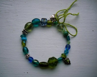 Blue and Green Glass Bead Bracelet, Silver Charms, Green Tie, Beaded