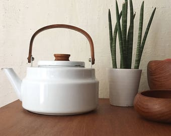 White enameled Scandinavian kettle and teak