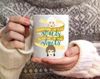 The Golden Girls Dorothy in the Streets Blanche Devereaux in the Sheets Funny Coffee Mug Drink Cup