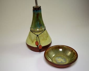 Olive oil dispenser set with a small bowl for dipping sauce in beautiful blue and light green glazes