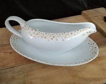 White ceramic gravy boat hand painted with gold dots