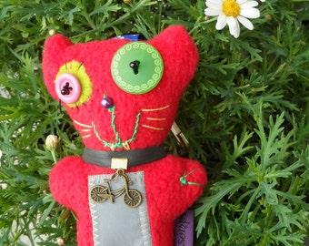 Red bicycle cat Pocket-Zsömpi