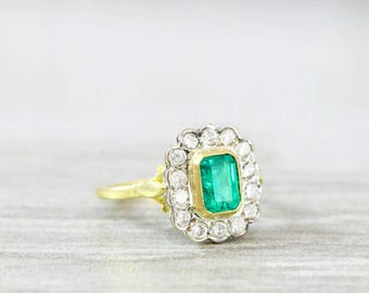 Vintage restored emerald and diamond halo ring in 18 carat gold unique for her