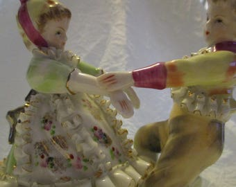 Vintage ceramic Dresden Style Unmarked Spinning or dancing boy and girl
