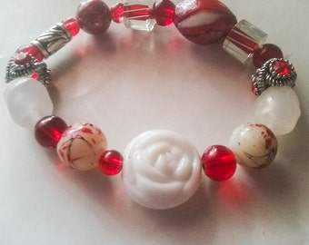 White rose and red beaded stretch bracelet