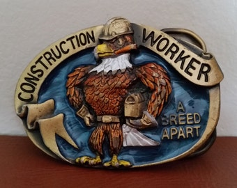 A Vintage Enamel Belt Buckle 1988 - Construction Worker-A Breed Apart By The Great American Buckle Co. Vintage American Belt Buckle. No 1881