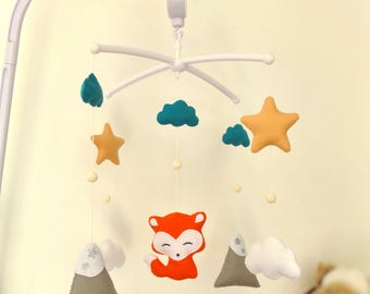 Baby crib musical mobile. Felt suspension with fox , mountain , star , cloud