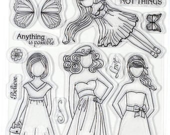 Paper Dolls Acrylic Stamps by Hot Of the Press has 4 different size dolls with sentiments and embellishments. Item is new. Free Shipping!!!!