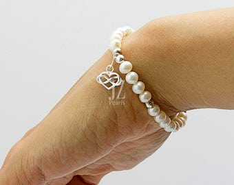 Freshwater Cultured Pearl Bracelet with a Sterling Silver Infinity entwined Heart Charm interspersed with Sterling Silver Beads. Love Gift